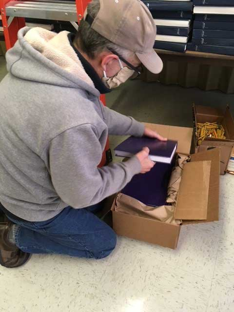 Taking delivery of the new hymnals on January 20, 2021